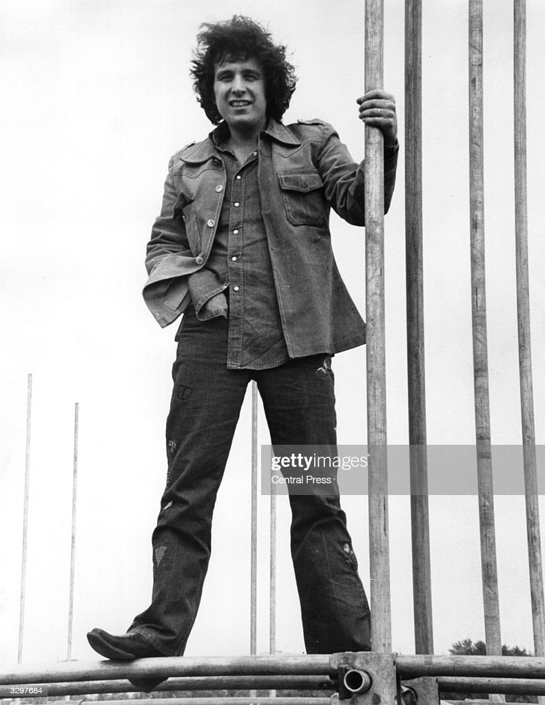 American folk-pop singer Don McLean, who topped the British charts with his records 'American Pie' and 'Vincent', climbs the scaffolding in Hyde Park, where he will be giving a free concert at the end of his tour.