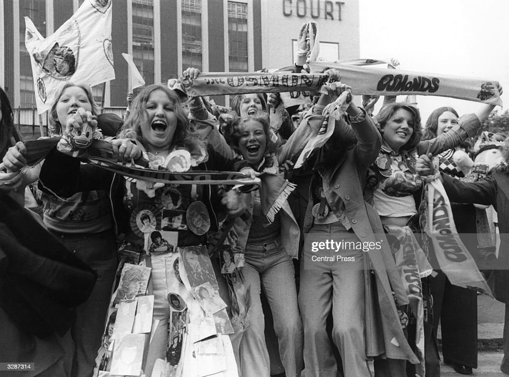 Excited female Osmond fans wait outside Earls Court exhibition hall in London, where their pop idols will perform later that evening.