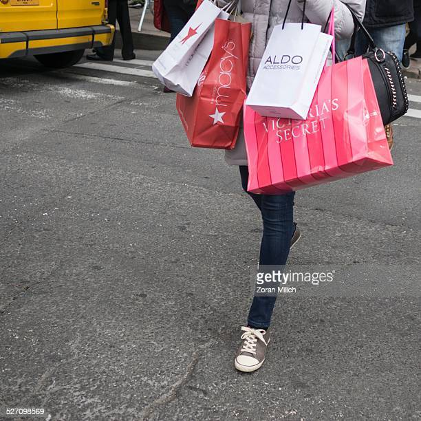 28th Nov 2014 shopper carries bags on Black Friday sales at Macy's Department Store in The Manhattan Borough of New York New York USA