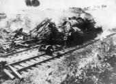 This Nazi fuel supply train has been blown up and derailed by the French Patriots near WaremineLeGrand in France holding up rail traffic for five days