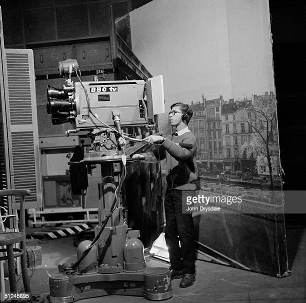 28th November 1962 A cameraman with one of the back projections of Paris used in the BBC television series 'Maigret' based on the detective novels of...