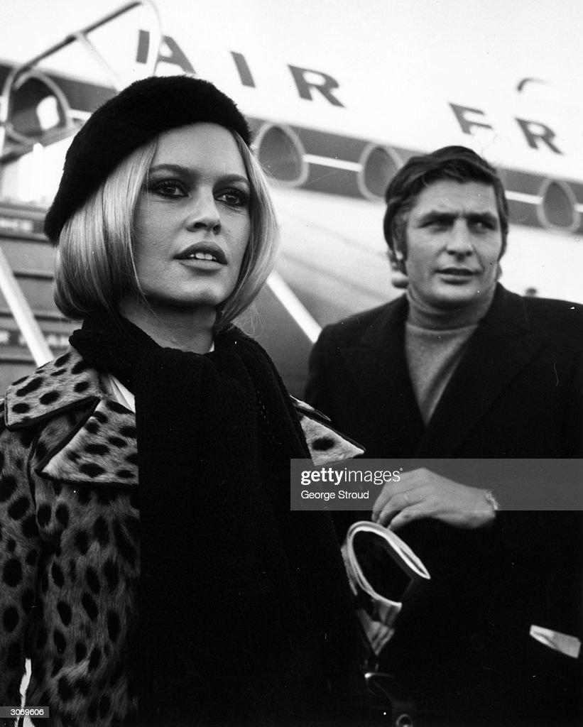 Brigitte Bardot (Camille Javal) and her third husband Gunter Sachs arrive at London airport.