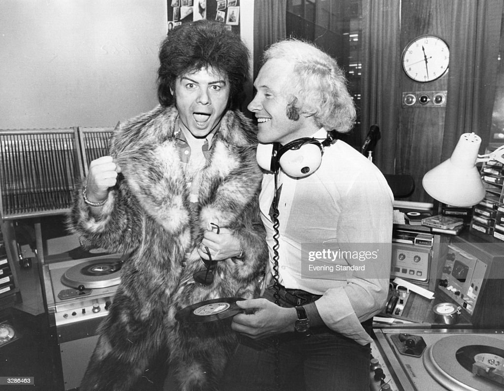 Glam pop star <a gi-track='captionPersonalityLinkClicked' href=/galleries/search?phrase=Gary+Glitter&family=editorial&specificpeople=228004 ng-click='$event.stopPropagation()'>Gary Glitter</a>, left, with DJ David 'Diddy' Hamilton. Glitter is making his first national broadcast since his successful throat operation on Hamilton's Radio One show, Diddy holds a copy of Gary's latest single 'Oh Yes You're Beautiful'.