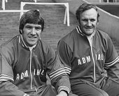 The England football manager Don Revie with his captain Emlyn Hughes during a training session at Wembley before a game against Hungary