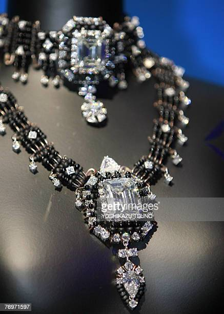 A 290carat 'Ponahalo' necklace which includes a 102carat emerald and a 70carat diamond as its centre pieces is seen on display during De Beers...