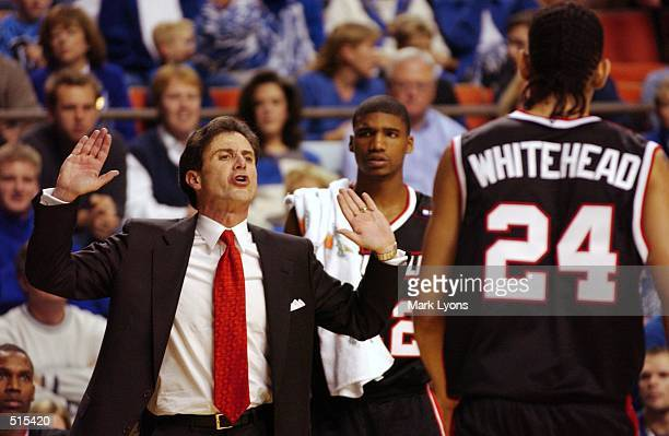 University of louisville coach Rick Pitino talks to his player Luke Whithead as he come out of the game against the Univeristy of Kentucky at Rupp...