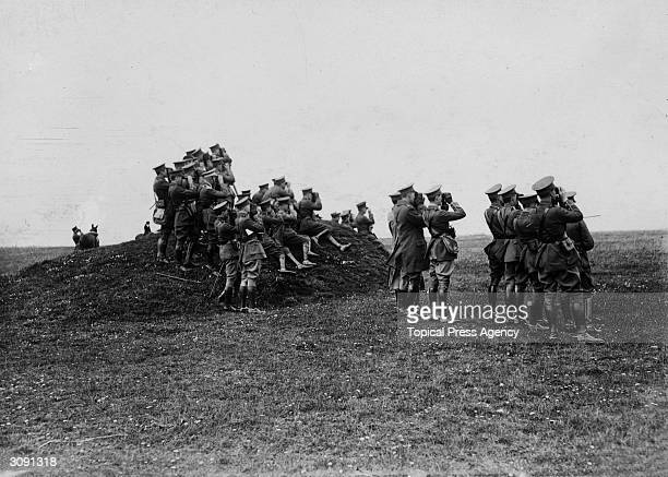 Groups of officers watching the results of firing by the artillery on Salisbury Plain Wiltshire