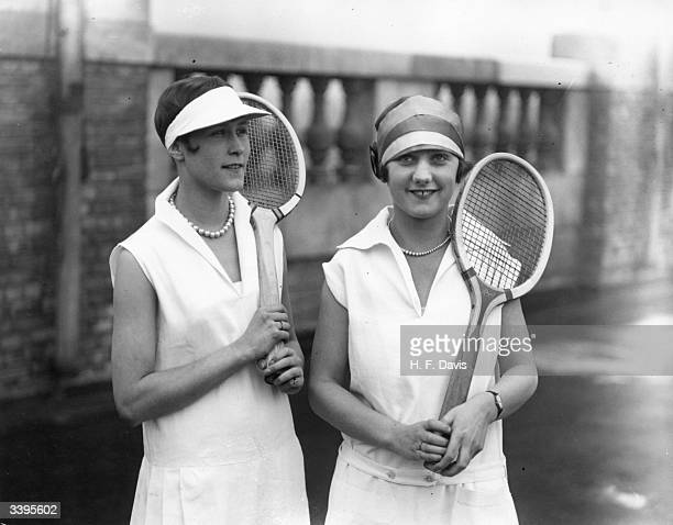 The perfect tennis costume for the coming season worn by two players includes a pique frock roll stockings eye shade and light shoes