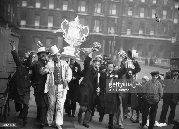Manchester City football fans arrive in high spiritst at Euston Station London for their team's FA Cup Final against Everton
