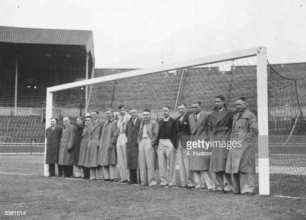 The Huddersfield Town Football Club team inspect the pitch at Wembley with only a few days to go before their FA Cup final match against Preston...