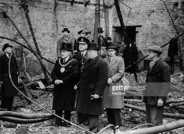 Prime Minister Winston Churchill inspecting the ruins of Manchester's Free Trade Hall after a bombing raid in WW II