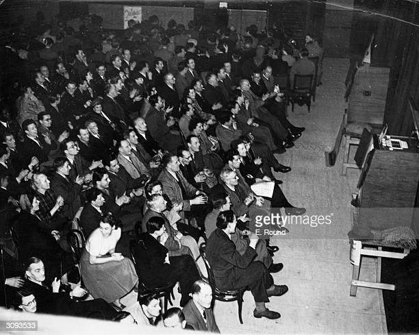 Some of the 500 people sitting in comfort in Kensingtown Town Hall to watch a Wembley Cup final on twenty TV sets The enterprise was organised by...