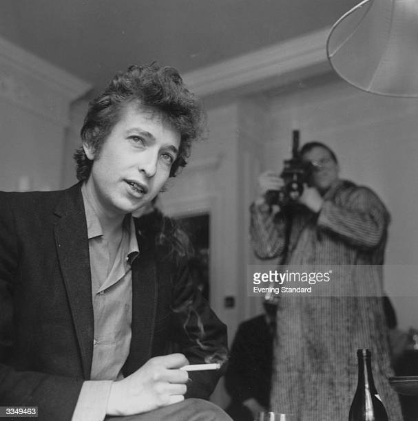 A cameraman films American folkrock singer Bob Dylan during an interview