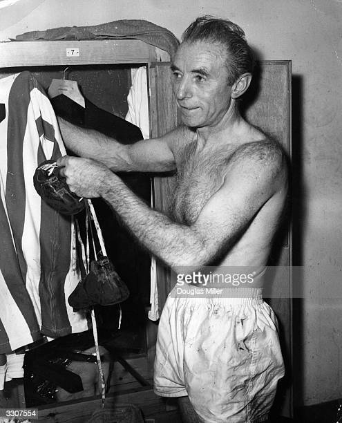 Sir Stanley Matthews aged 50 hangs up his boots for the last time after playing a farewell match for the Stanley Matthews XI against a World XI at...