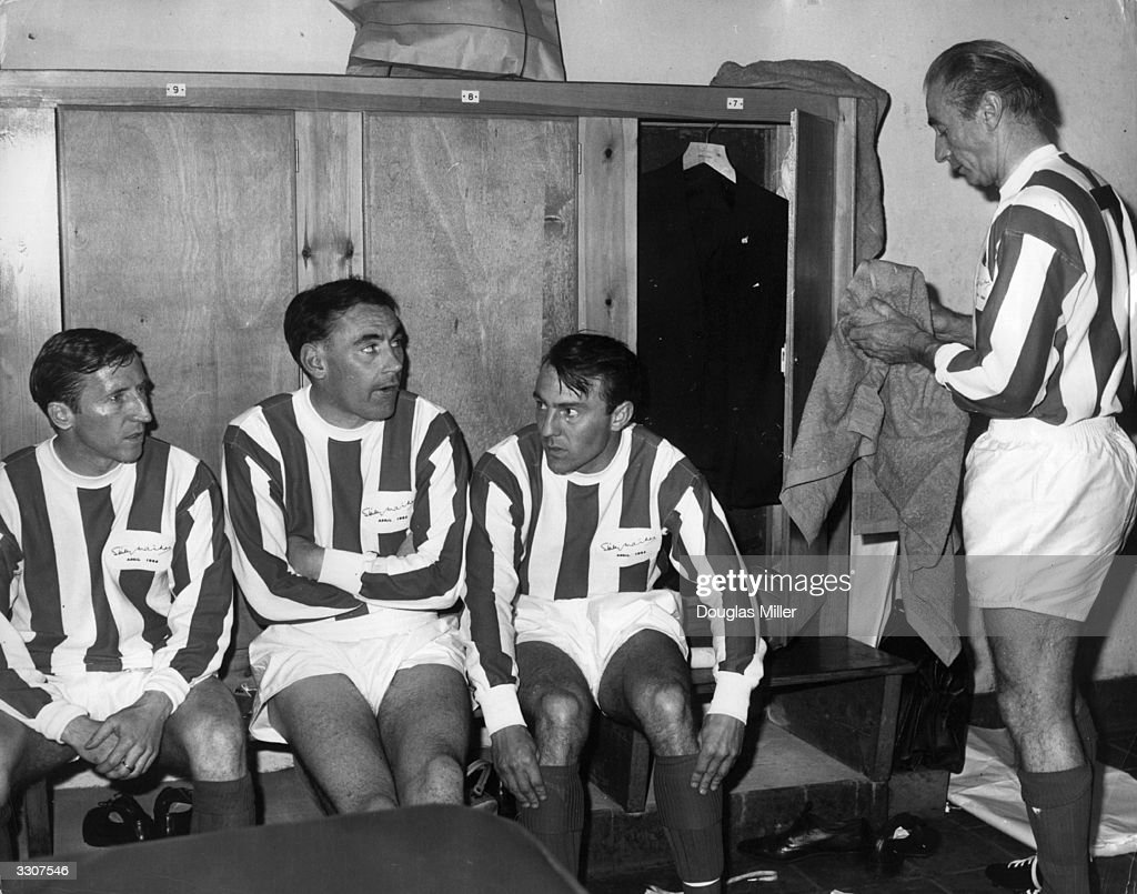 Sir Stanley Matthews aged 50 in the changing room with three Tottenham Hotspur players Cliff Jones Alan Gilzean Jimmy Greaves before playing a...
