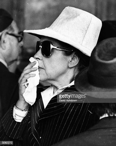 British actress Diana Coupland attending the funeral of comedian Sid James at Golders Green London