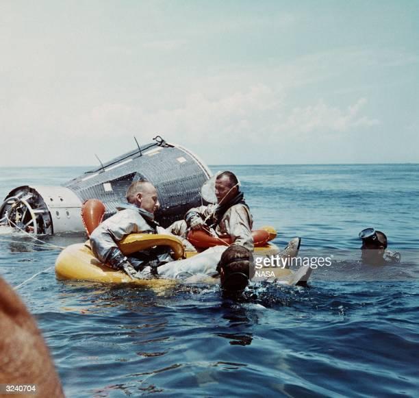 Navy divers recover Commander C Gordon Cooper and pilot Charles 'Pete' Conrad Jr after the splashdown of the Gemini V capsule in the Atlantic Ocean