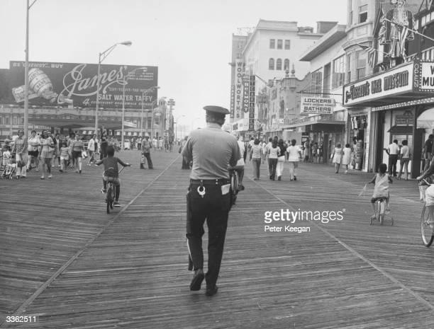A policeman walking along the boardwalk at Atlantic City New Jersey USA