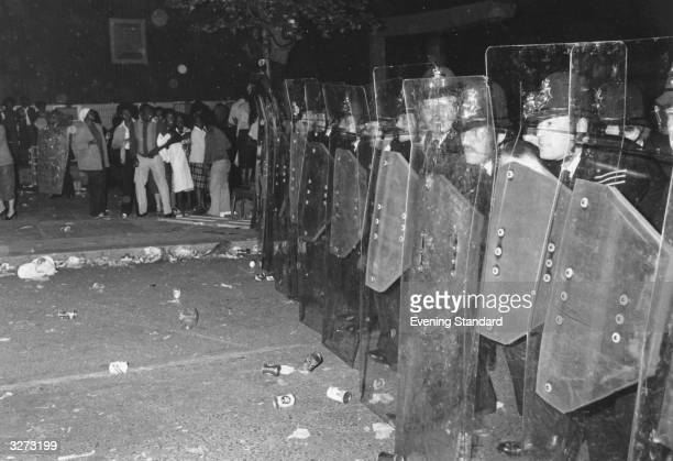 Police with riot shields during the Notting Hill Carnival