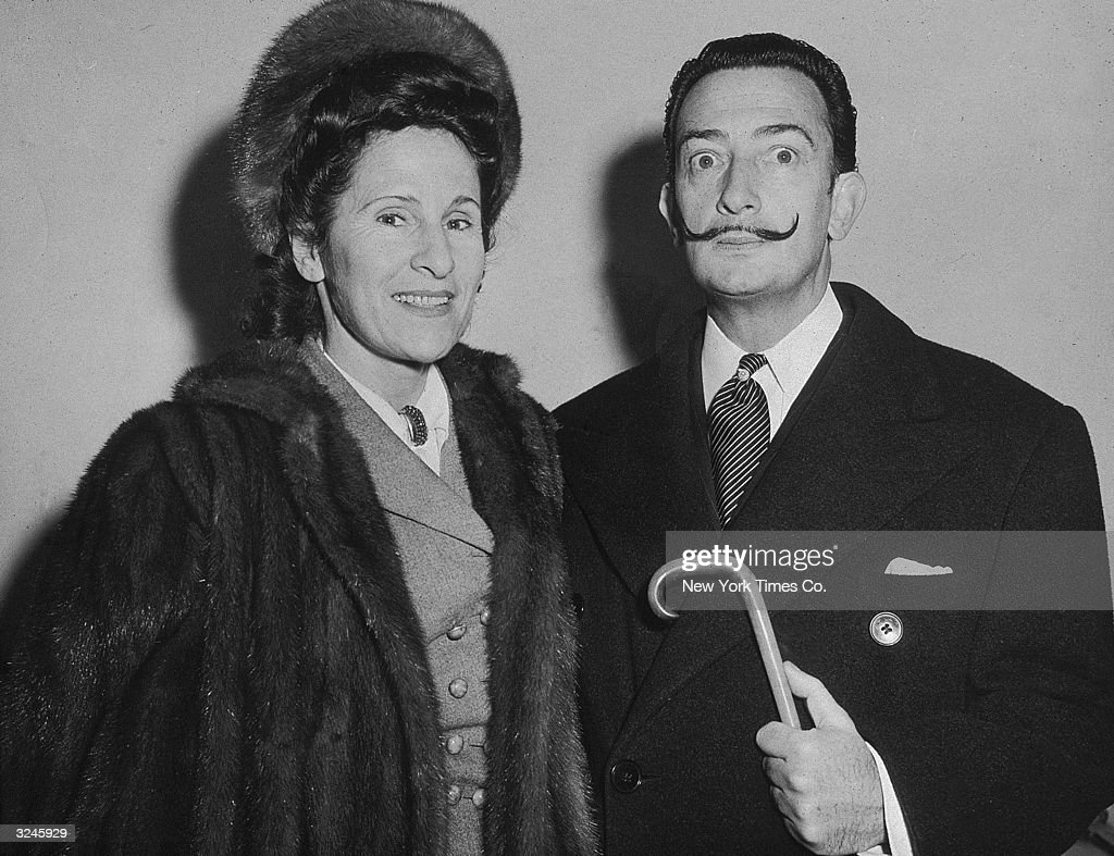 Spanish surrealist painter Salvador Dali posing with his wife Gala on the ship 'Vulcania' upon arrival in New York City