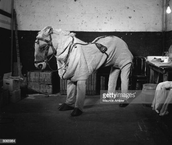A pantomime horse played by Jock Young and Charlie Mills Original Publication Picture Post 5642 Brothers Under The Skin pub 1951