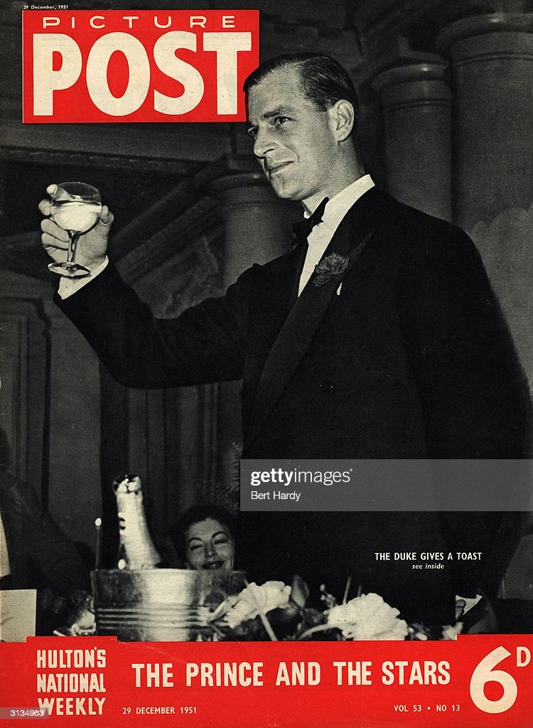 Prince Philip, the Duke of Einburgh proposing a toast on behalf of the 'Guests' at a dinner for British and American show people and members of the Variety Club of Great Britain after a midnight matinee in aid of the National Playing Fields Association. Original Publication: Picture Post - Cover - pub.1951