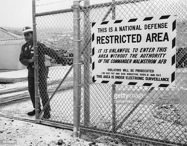 A guard closing the gate to entrance of the control centre of the missile base at Malstrom Montana USA where the balistic missile 'Minuteman' is kept