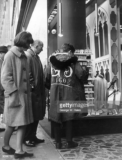 A young mod windowshopping in Oxford Street London and wearing a parka