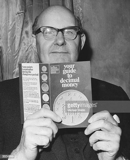 Lord Fiske Chairman of the Decimal Currency Board holding up a copy of the booklet which describes the new decimal coins at a press conference at the...