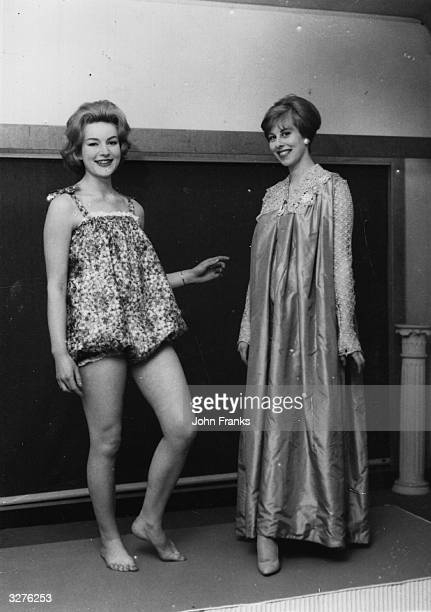 Cathrine Burgess wears a 160 year old maternity dress while her companion Jane Trevor models a moderm maternity swimming costume
