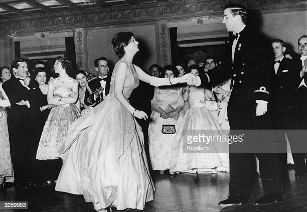 Crown Prince Constantine dances a ChaCha with a young woman at the annual Royal Ball attended by all the Greek Royal Family members at the Parnassos...