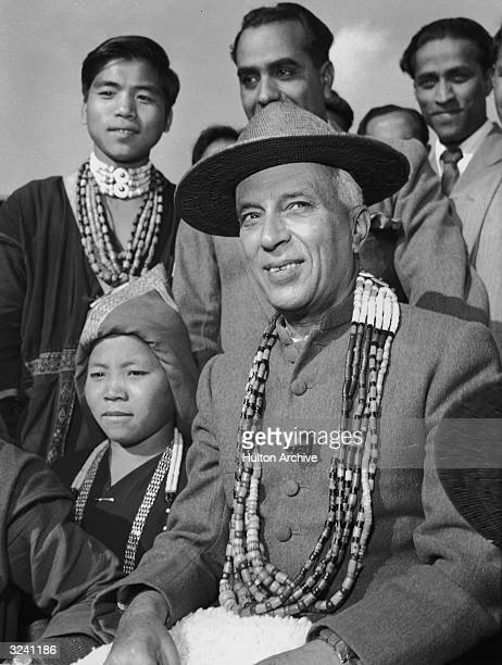A portrait of Indian Prime Minister Jawaharlal Nehru wearing a jacket with a Nehru collar and multiple strand of beads seated amongst Republic Day...