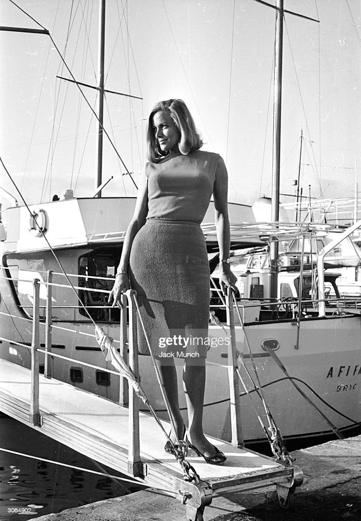Actress Honor Blackman poses on a gangplank.