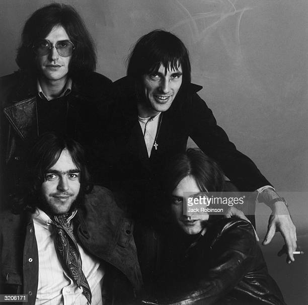 Group studio portrait of the British rock band The Kinks Clockwise from top left guitarist Ray Davies drummer Mick Avory guitarist Dave Davies and...