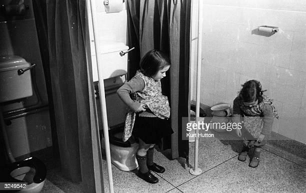 Two little girls in the school toilets Original Publication Picture Post 1760 Nursery School pub 1944