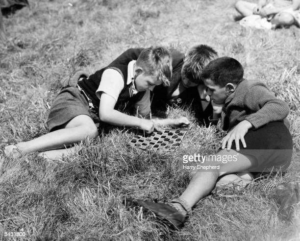 Schoolboys from England and France playing draughts at a holiday camp in Brighton The camp attended by children from ten European countries was...