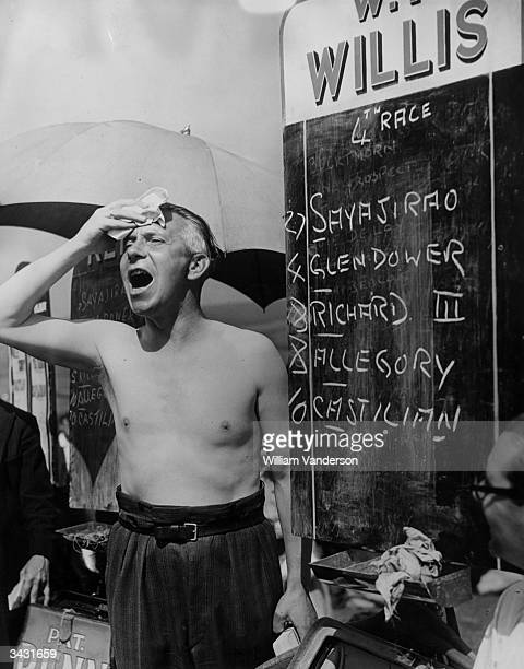 Bookmaker Bill Willis working in a heatwave at Goodwood Race Course on the first day of the four day summer meeting