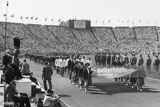 Athletes parading during the Opening Ceremony of the Olympic Games at Wembley Stadium Original Publication Picture Post 4582 Our Welcome To Olympic...
