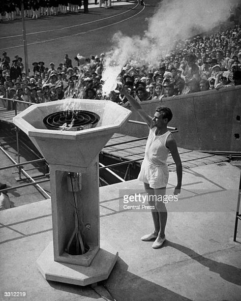British athlete John Mark lights the Olympic Flame at the opening ceremony of the Olympic Games at Wembley Stadium London