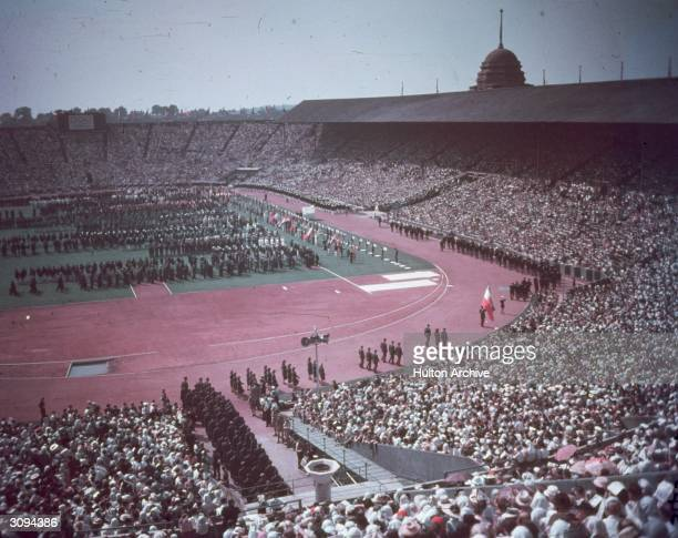 The opening day of the 14th Olympic Games at Wembley Stadium North London