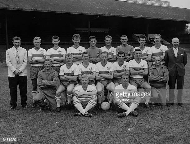 Millwall Football Club players at their ground back row Dave Harper Tommy Wilson Carl Wilson Peter Reader Gary Townend Reg Davis David Jones and Ray...