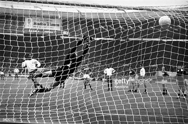 Portugal's Eusebio hammers his penalty kick past Russia's Lev Yashin to put his country in the lead during the World Cup third place play off game at...