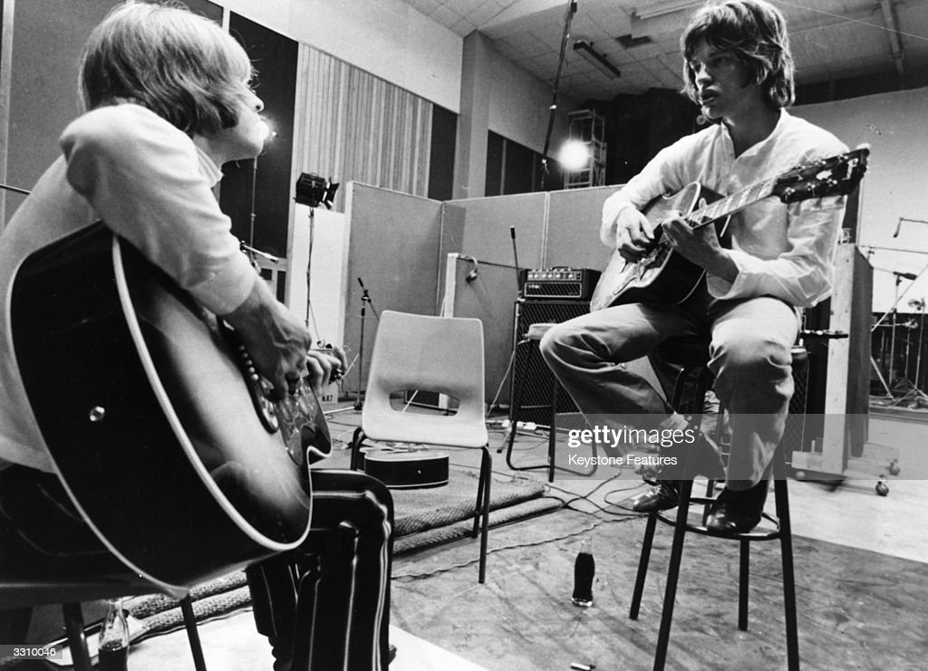 Brian Jones and Mick Jagger of the Rolling Stones jamming a tune in a recording studio which evolved into the song 'Sympathy For The Devil' as...