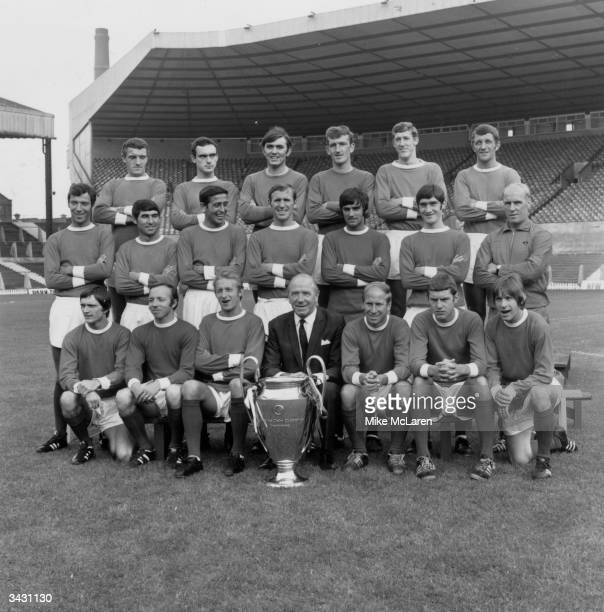 The Manchester United team at Old Trafford Manchester with the European Cup Bill Foulkes John Aston Jimmy Rimmer Alex Stepney Alan Gowling and David...