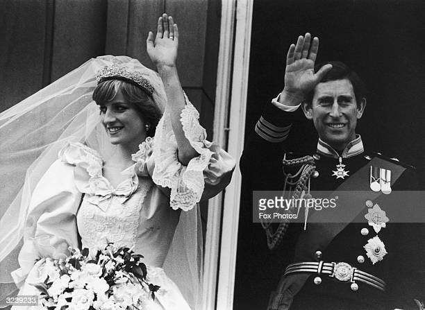 Charles Prince of Wales and Diana Princess of Wales waving to crowds from the balcony of Buckingham Palace London after their wedding