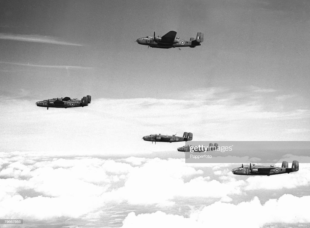 29th July American Mitchell B25 day bombers flying in formation during World War Two