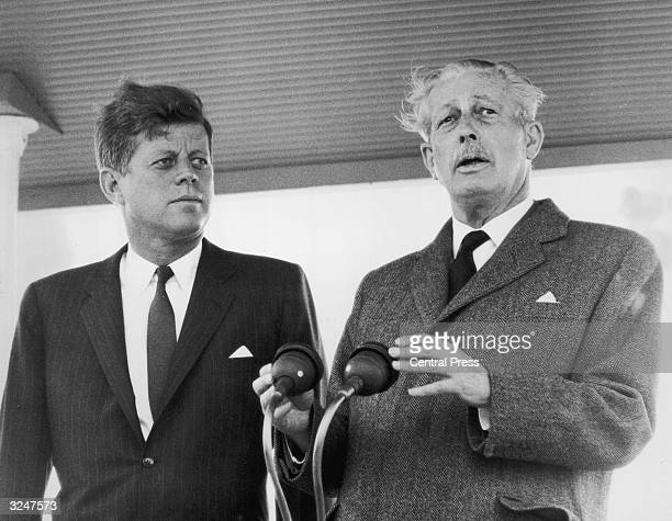 US president John F Kennedy receives a public welcome from British prime minister Harold Macmillan upon his arrival at Gatwick Airport From there the...
