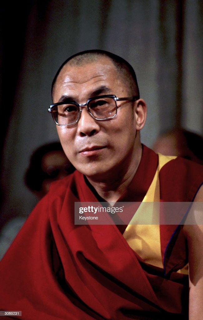 The fourteenth Dalai Lama, spiritual and temporal ruler of Tibet, arrives at Heathrow Airport, London.