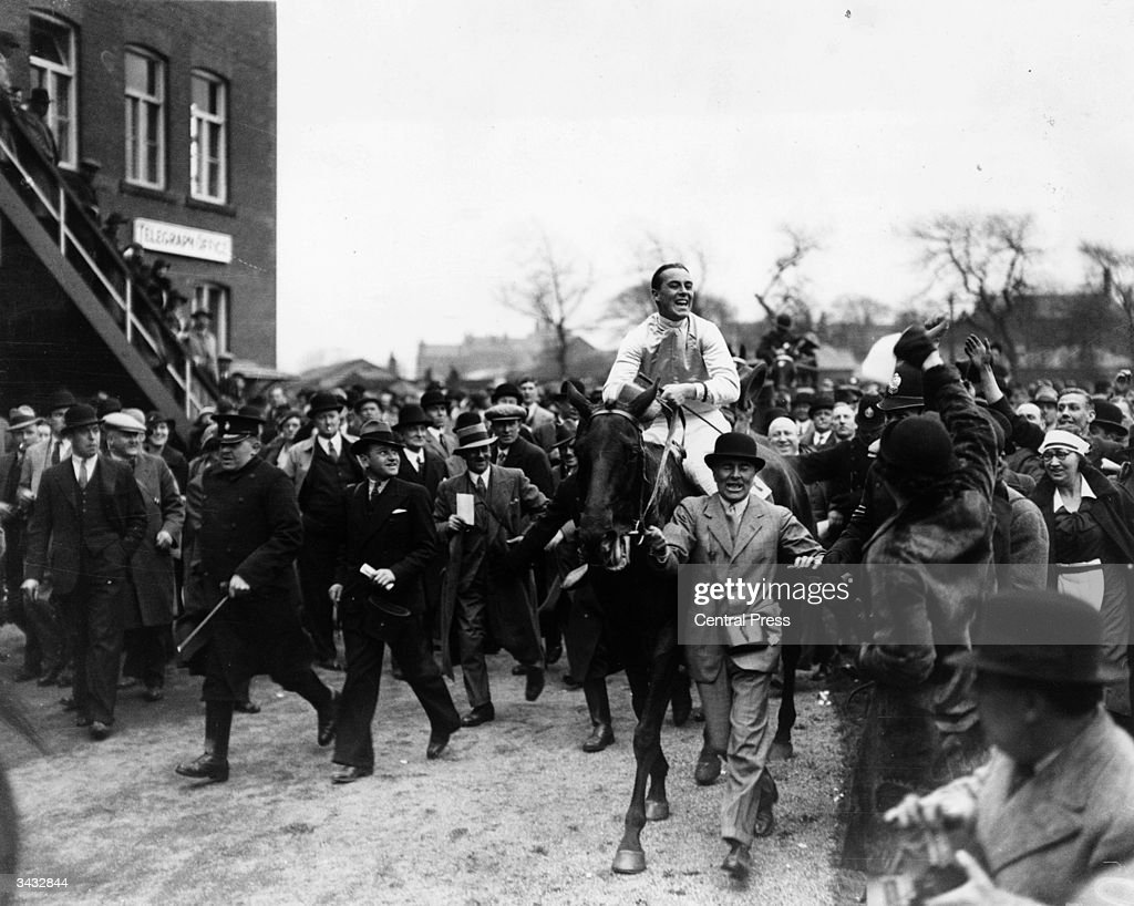 Owner, Major Noel Furlong leading in Reynoldstown ridden by his son Frank Furlong after they had won the Grand National at Aintree, near Liverpool.