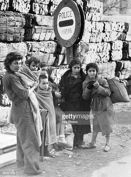 A family of refugees from the Spanish civil war at the border between France and Spain
